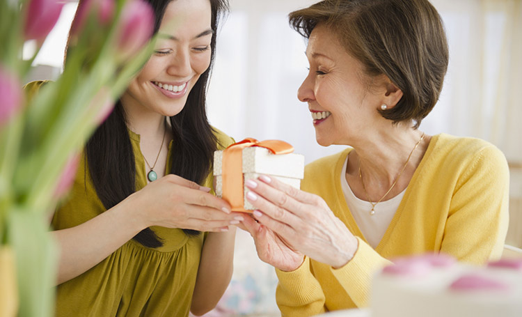 Japanese daughter giving mother gift